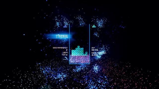 Screenshot: Das erste Level des Abenteuermodus von Tetris Effect, The Deep mit ordentlichem Partikelfeuerwerk